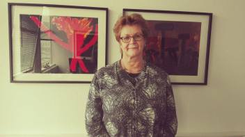 Gudrun Jonsdottir in front of pictures by Kristine