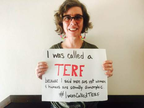 "Thistle holds a sign that reads, ""I was called a TERF because I said men are not women & humans are sexually dimorphic. #IWasCalledTERF"""