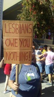 "An Amazon's sign reads, ""Lesbians Owe You NOTHING!"""
