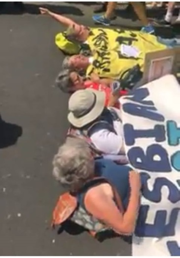 Activists lay their bodies down, blocking London Pride from beginning, in protest of Lesbian erasure.