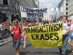 "Activists lead London Pride carrying banners that read ""Lesbian = Female Homosexual"" and ""Transactivism Erases Lesbians."""